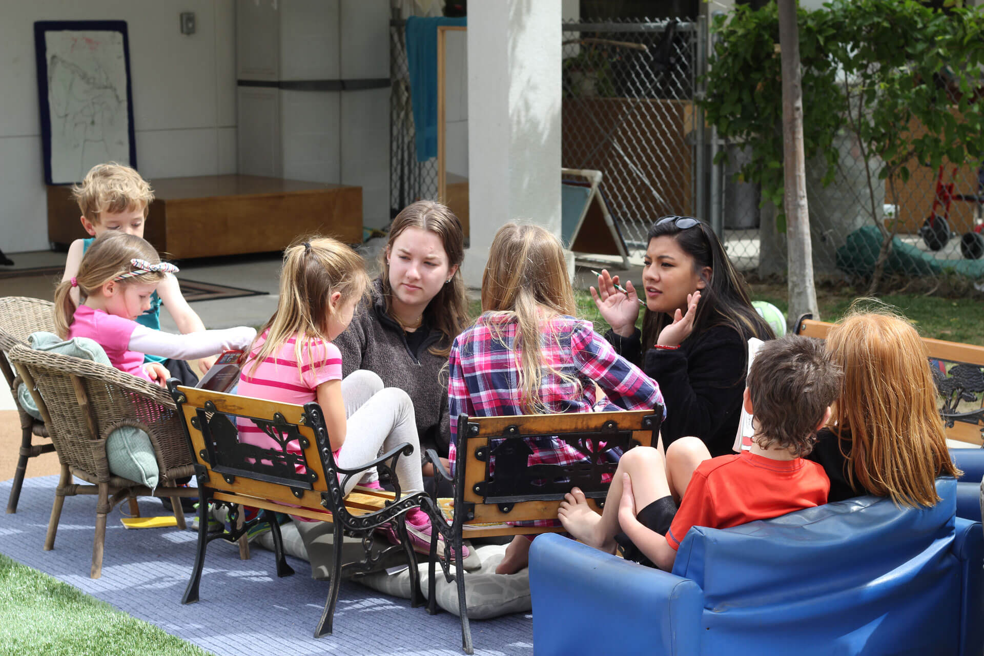 student teachers and children in the outdoor classroom